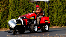 Steiner compact tractor clearing leaves with Turbine Power Blower