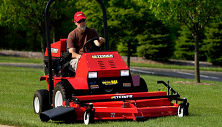 Steiner compact tractor mowing with side discharge mower