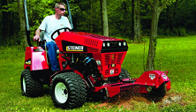 Steiner compact tractor with stump cutter