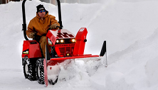 Steiner compact tractor with snow blower attachment