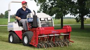 Ventrac compact tractor with aerator attachment