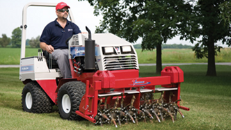 Ventrac compact tractor with aerator attachment
