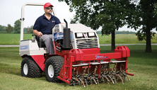 Ventrac 4500 compact tractor with aerator attachment
