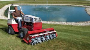 """Ventrac tractor with """"Aeravator"""" attachment"""