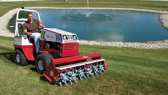 Ventrac tractor with aeravator attachment