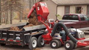 Ventrac collection system using high lift mechanism to dump debris