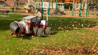 Ventrac tractor with turbine blower attachment