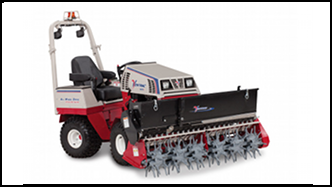 Ventrac 4500 series compact tractor with Aera-Vator and Seed Box attachments