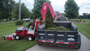 Dumping contents of the collection bin into a truck bed. Click for details.