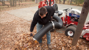 Ventrac collection system hose used as manual leaf vacuum. Click for details.