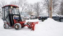 Ventrac 4500 tractor with heated cab and hydraulic v-blade snow plow. Click for more detail.