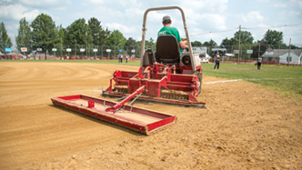 Ventrac ballpark groomer using cocoa mat to level field. Click for more detail