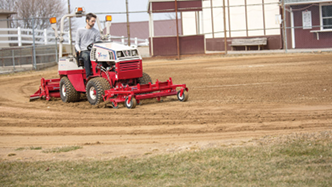 Ventrac ballpark groomer repairs a ballfield. Click for more detail.