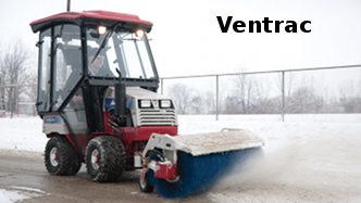 Ventrac compact tractor with rotating broom