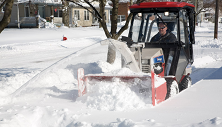 Ventrac 4500 with KX523 snow blower on city sidewalk. Click image for snowblower specs