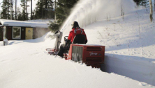 Ventrac 3400 tractor with snow blower clears deep snow. Click image to see specs on snow blower