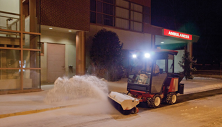 Ventrac 3400 sweeps snow in front of hospital. Click image for broom specs.