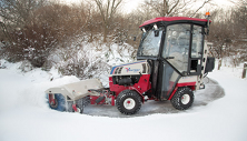 Ventrac 4500 with rotating snow broom. Click image to see Broom specs