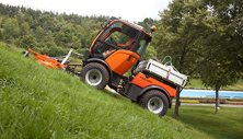 Holder compact tractor working as slope mower.