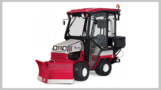 Ventrac 4500 tractor with heated cab and v-blade snow plow. Click image for specs.