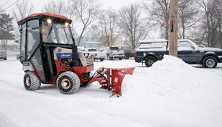 Ventrac 4500 with V-blade piling snow. Click image for V-blade specs