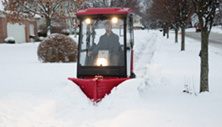 Ventrac 3400 clears sidewalk with V-blade. Click the image for V-blade specs