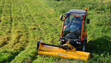 Holder tractor with flail mower cuts large field. Click image for details.