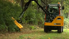 Holder tractor clearing trail with power arm flail mower (click image for specs)