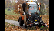 Holder tractor sweep vacuums park path.