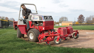 Edging the in-field with Ventrac's baseball field renovator. Click for more detail.