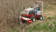Ventrac rough cut mower takes down thick bushes. Click image for more detail