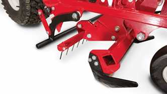 Close-up of edger and weed cutter on Ventrac baseball field renovator. Click for more detail.