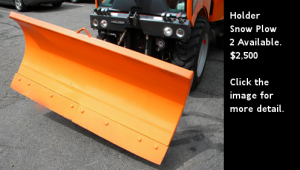 Used Holder tractor snow plow - 60 inch. Click the image for more detail.