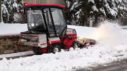 Ventrac 4500 Winter ready featuring the HB580 Broom, SA250 Spreader, and KW452 Cab with Heat