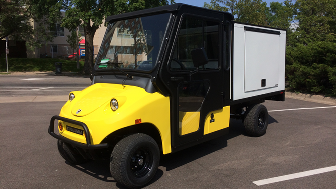 Customized Columbia Parcar electric utility vehicle with enclosed cab and extended van body. Click the image for details.