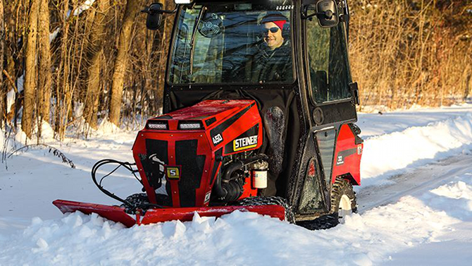 Steiner 450 Compact Tractor with Cab and V-blade