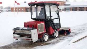 Ventrac sidewalk drop spreader in action. Click the image for details.