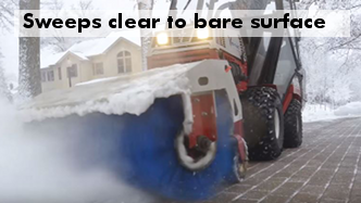 Ventrac HB580 rotating broom sweeping snow down to bare pavement