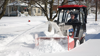 All season compact tractors blow snow