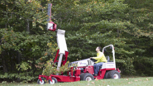 The Ventrac boom mower extends vertically more than 11 feet from the ground