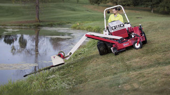 Maintain lake shores, ponds, and deep ditches with the Ventrac boom mower