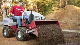 All season compact tractors haul rock