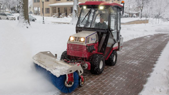 All season compact tractors sweep snow