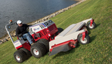 Ventrac tractor mower attachment mows on steep slope