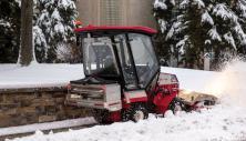 Ventrac tractor with drop spreader